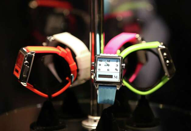 LAS VEGAS, NV - JANUARY 07:  Watches made by Martian Watches are displayed during the 2013 International CES Digital Experience media preview at the MGM Grand Conference Center on January 7, 2013 in Las Vegas, Nevada. CES, the world's largest annual consumer technology trade show, runs from January 8-11 and is expected to feature 3,100 exhibitors showing off their latest products and services to about 150,000 attendees. Photo: Justin Sullivan, Getty Images / 2013 Getty Images