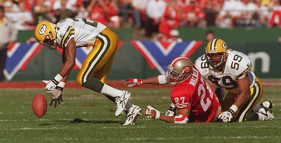 The Packers' Craig Newsome (left), picks up a fumble by 49ers' fill-in fullback Adam Walker (center) in a loss in which Steve Young threw 65 passes. Photo: Deanne Fitzmaurice, STAFF