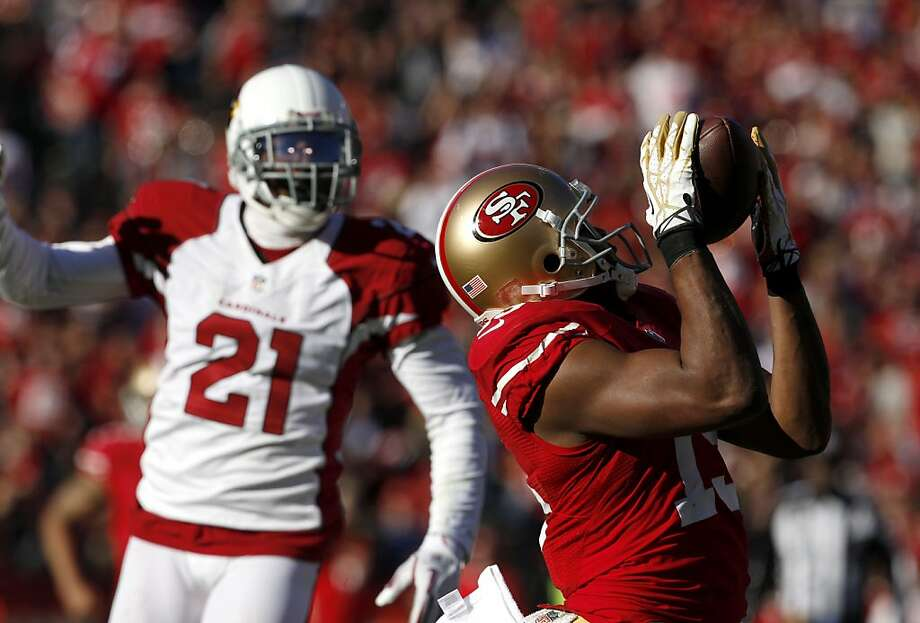 With his big game against Arizona, Michael Crabtree became the first 49ers receiver since 2003 with a 1,000-yard season. Photo: Carlos Avila Gonzalez, The Chronicle