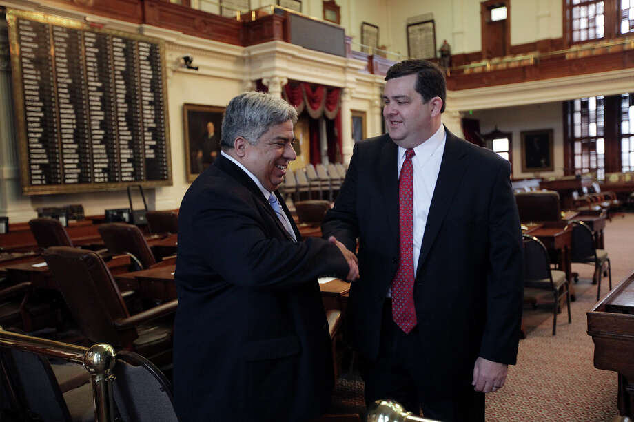 District 62 St. Rep. Larry Phillips, right, shakes hands with outgoing St. Rep. Dist. 40 Aaron Pena (tilde over the n), before the start of the 83rd Texas Legislature at the State Capitol in Austin, Tuesday, Jan. 8, 2013. Photo: Jerry Lara, San Antonio Express-News / © 2013 San Antonio Express-News