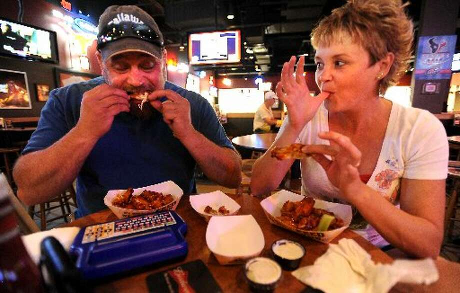 Max Hadaway and Kelly Hadaway eat 45 cent wings at Buffalo Wild Wings in Beaumont. Tammy McKinley/cat5
