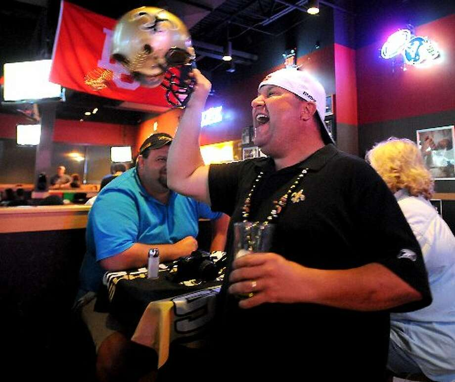 Shannon Barrios cheers for the Saints during the game againt Minnasota at Buffalo Wild Wings in Beaumont. Tammy McKinley/cat5