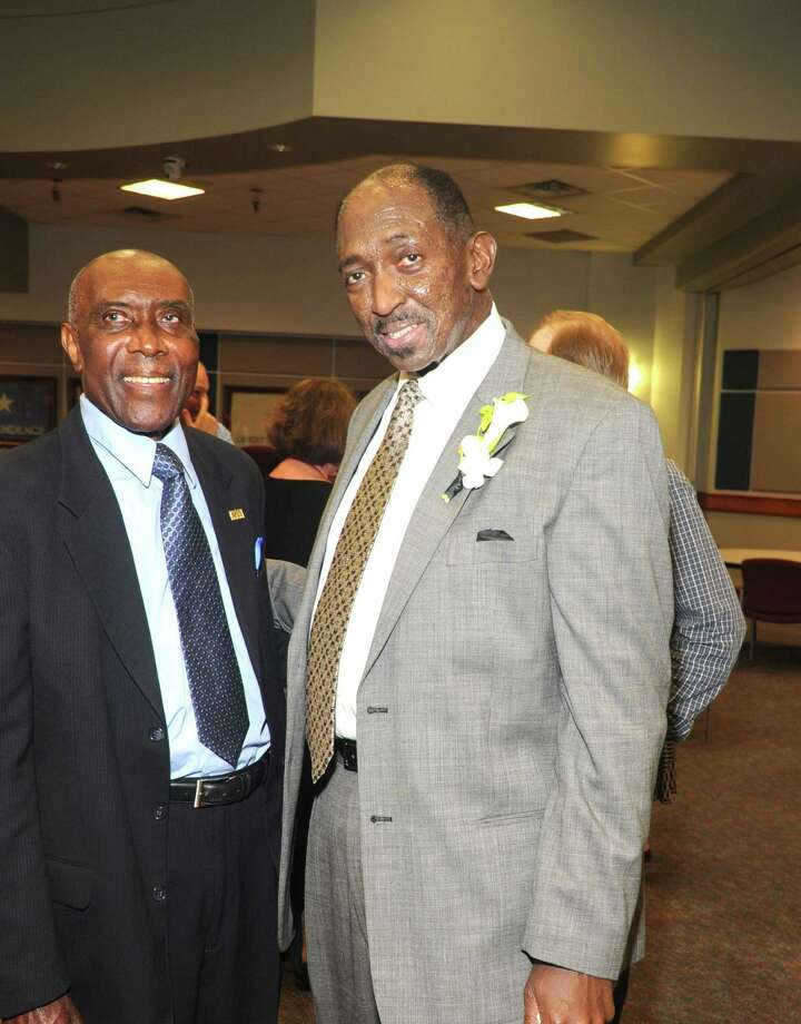 Retired Katy Independent School District Administrator Roosevelt Alexander, left, visits with O.D. Tompkins Jr. as his retirement from the position of executive director for campus administrative in the Katy ISD. Photo: Eddy Matchette, Freelance / Freelance