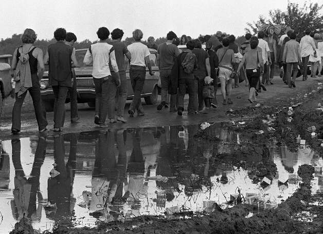 (1969) Approximately 500,000 concert-goers attend Woodstock. / AP1969