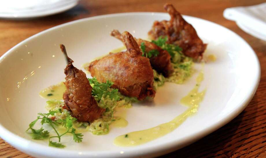 Friedn Semi-Boneless Quail with shaved brussel sprout slaw, pine nuts and mustard dressing at South End restaurant in New Canaan on Wednesday, December 19, 2012. Photo: Lindsay Niegelberg, Niegelberg / Stamford Advocate