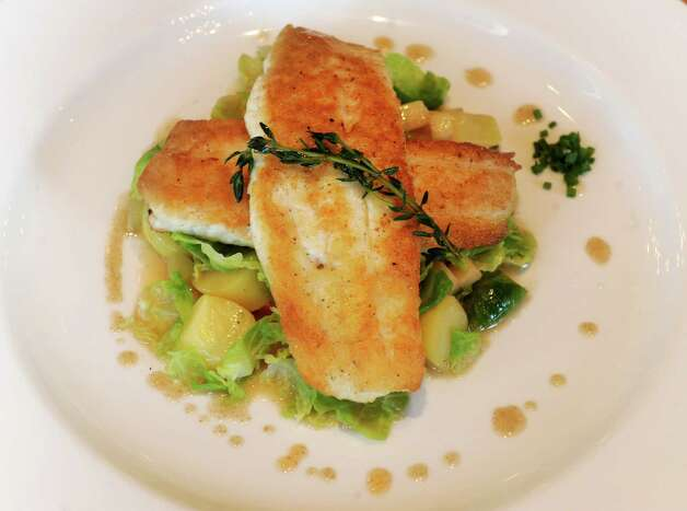 Montauk Fluke with brussel sprouts, gala apples and apple cider butter at South End restaurant in New Canaan on Wednesday, December 19, 2012. Photo: Lindsay Niegelberg, Niegelberg / Stamford Advocate