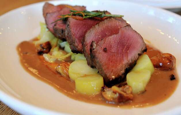 Roasted Venison Tenderloin with savoy cabbage, juniper and orange roasted chestnuts and puree with natural jus at South End restaurant in New Canaan on Wednesday, December 19, 2012. Photo: Lindsay Niegelberg, Niegelberg / Stamford Advocate