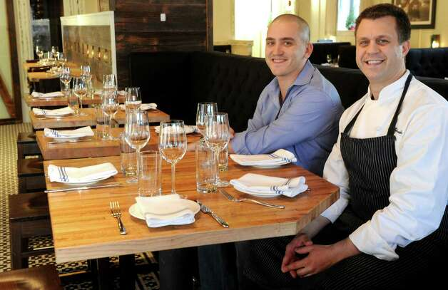 Keith Siskind, general manager and partner, left, and Nick Martschenko, chef and proprietor, right, pose for a photo at South End restaurant in New Canaan on Wednesday, December 19, 2012. Photo: Lindsay Niegelberg, Niegelberg / Stamford Advocate
