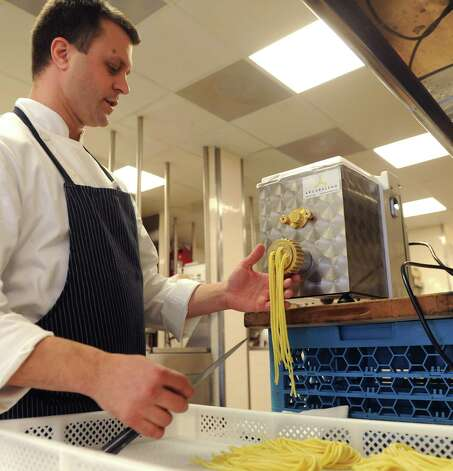 Nick Martchenko, Chef and Proprietor of South End restaurant in New Canaan, prepares homemade pasta on Wednesday, December 19, 2012. Photo: Lindsay Niegelberg, Niegelberg / Stamford Advocate