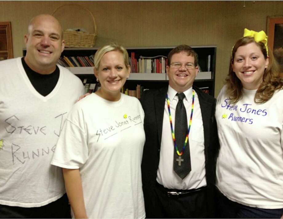 The Steve Jones runners will race for fellow church member Steve Jones, who is a longtime member of The Sunshine Kids, during the Aramco Houston Half Marathon on Jan. 13.  From left are: Brandon Schmidt, Amanda Schmidt, Jones and Jennie Urban. The Steve Jones runners will race for fellow church member Steve Jones, who is a longtime member of The Sunshine Kids, during the Aramco Houston Half Marathon on Jan. 13.  From left are: Brandon Schmidt, Amanda Schmidt, Jones and Jennie Urban.