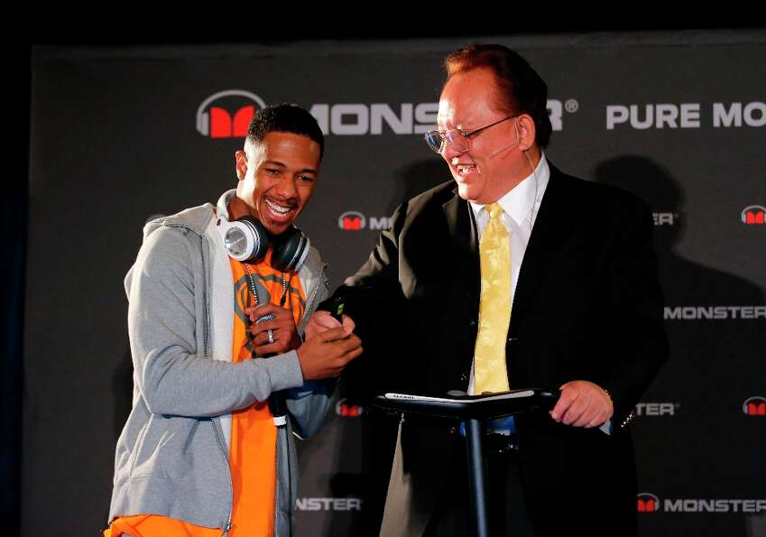 Recording artist Nick Cannon, left, shakes hands with Monster CEO Noel Lee during a new conference a