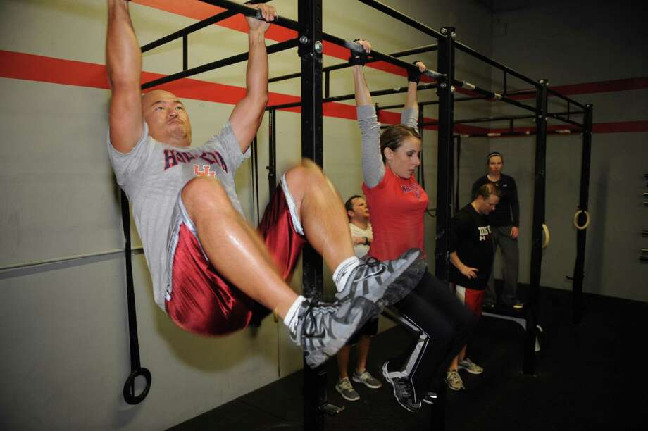 Hugh Kim and Yvette Duenas work out in a class at CrossFit Memorial Houston, 1105 Upland Drive, Suite C. Photo: Thomas Nguyen, Freelance / Freelance