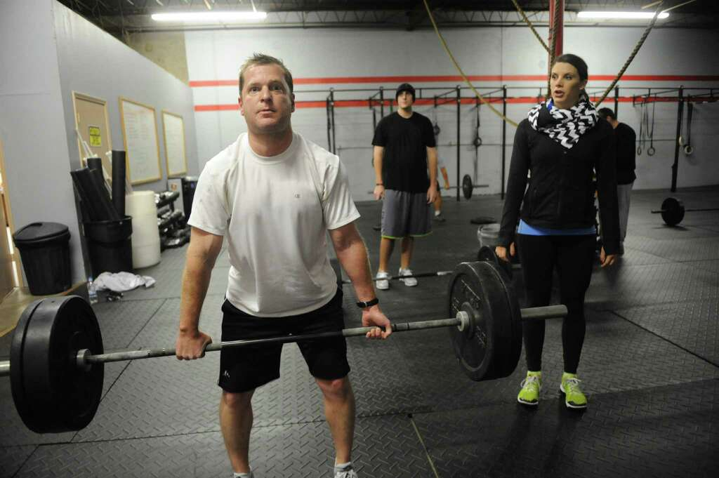 Trainer Megan Pepitone Works With Jay Gerber As He Lifts Weights At Crossfit Memorial Photo