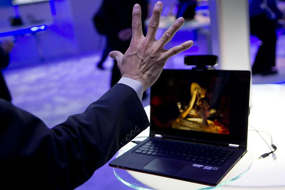 Jason Chow demonstrates perceptual technology with a Creative Technology Ltd. Interactive Gesture Camera at the Intel Corp. booth during the 2013 Consumer Electronics Show in Las Vegas, Nevada, U.S., on Tuesday, Jan. 8, 2013. Photo: Andrew Harrer, Bloomberg