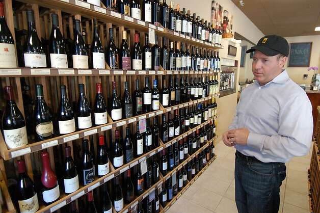 Jeff Alexander at Terranova Fine Wines in downtown Monterey notes the large selection of local wines for sale; the store also offers tastings with cheese plates and other food options. Photo: Jeanne Cooper, SFGate
