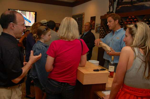 The Bernardus Winery tasting room in Carmel Valley can draw a crowd on weekends, but the staff still takes time to explain the varieties of grapes and terroirs that convinced Bordeaux lover Bernadus Pon to found a winery here. Photo: Jeanne Cooper, SFGate