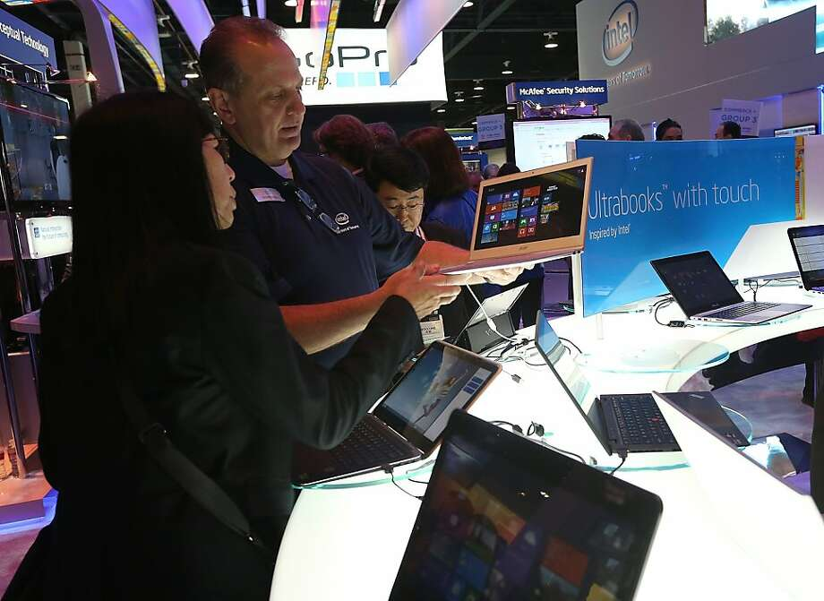 Attendees inspect Intel UltraBooks during the 2013 International CES at the Las Vegas Convention Center on January 8, 2013 in Las Vegas, Nevada. Photo: Justin Sullivan, Getty Images