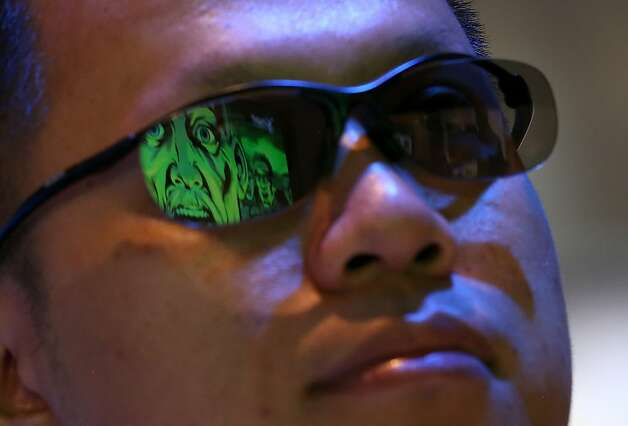A Sony 3-D movie is seen reflected in an attendee's glasses during the 2013 International CES at the Las Vegas Convention Center on January 8, 2013 in Las Vegas, Nevada. Photo: Justin Sullivan, Getty Images