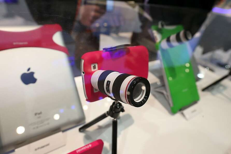 A Polaroid lens adapter for an iPhone is displayed during the 2013 International CES at the Las Vega