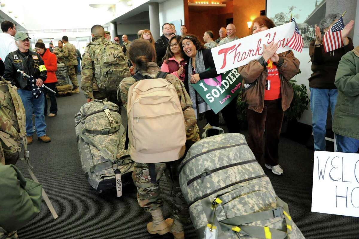 Troops from the 27th Infantry Brigade arrive home to cheers on Tuesday, Jan. 8, 2013, at Albany International Airport in Colonie, N.Y. Troops reunite with family and friends following their deployment to Kuwait in support of Operation Enduring Freedom. (Cindy Schultz / Times Union)