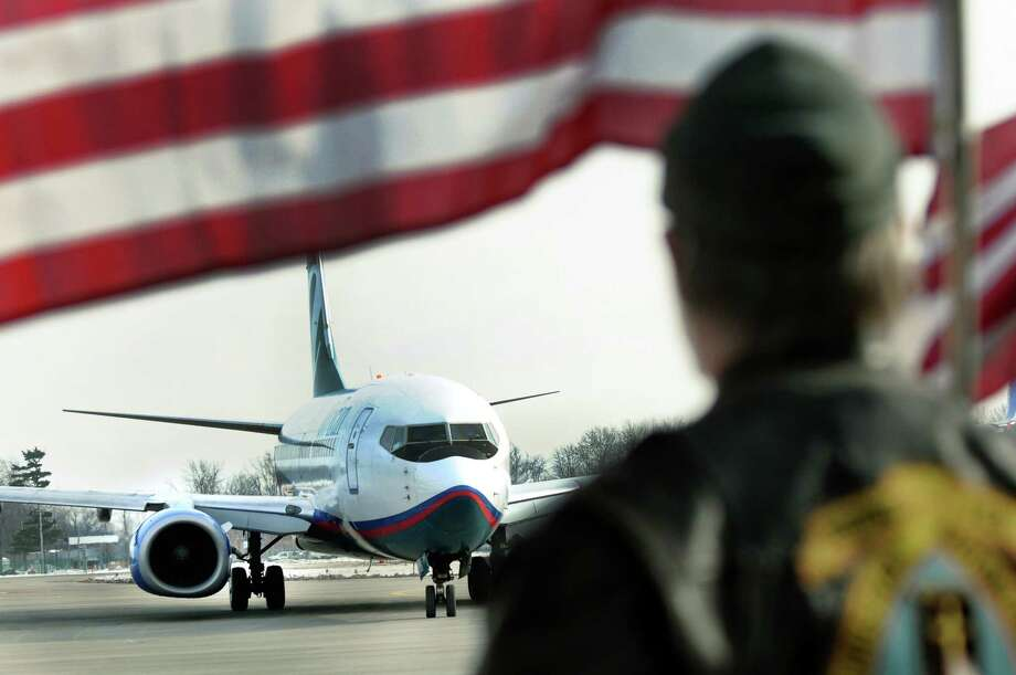The plane carrying troops from the 27th Infantry Brigade arrives on Tuesday, Jan. 8, 2013, at Albany International Airport in Colonie, N.Y. (Cindy Schultz / Times Union) Photo: Cindy Schultz / 00020696A