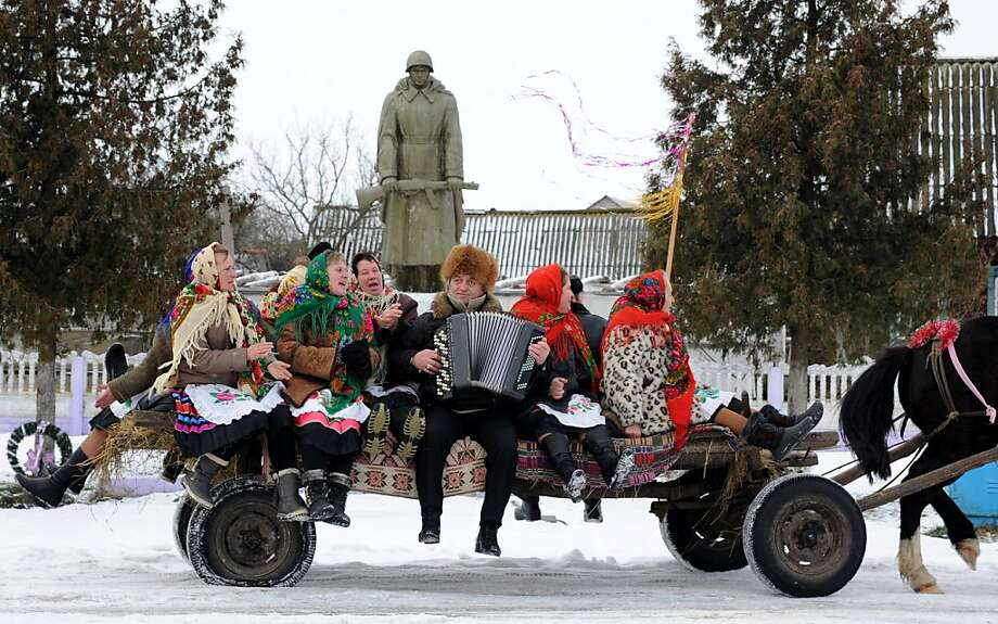 Oh, what fun it is to ride a one-horse open hay ... wagon: In Richev, Belarus, carolers celebrate Orthodox Christmas accordion to the Julian calendar. Photo: Viktor Drachev, AFP/Getty Images