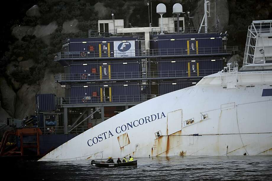 The capsized Costa Concordialies on its side near the port of the Italian island of Giglio. It's been nearly a year since the giant Italian cruise ship ran aground near the Tuscan island and pitched over, killing 32 people. Photo: Filippo Monteforte, AFP/Getty Images