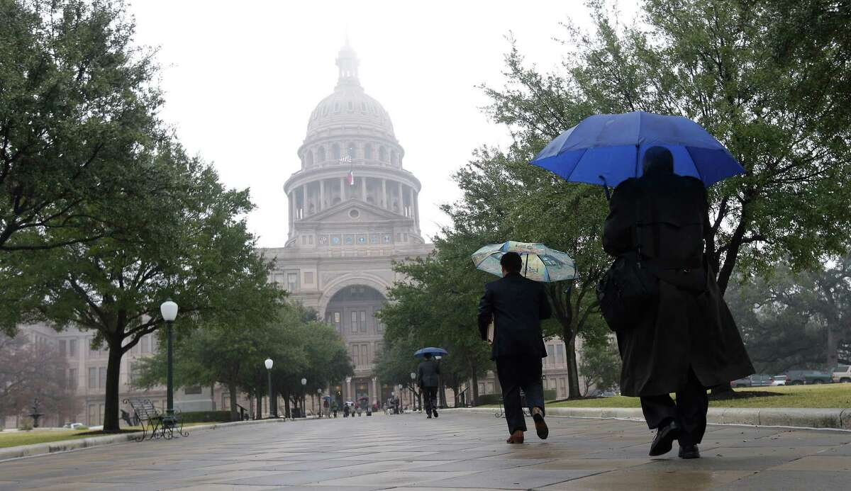 The Texas state capitol is masked by drizzle and fog on the opening day of the 83rd Texas Legislature session, Tuesday, Jan. 8, 2013, in Austin, Texas. (AP Photo/Eric Gay)