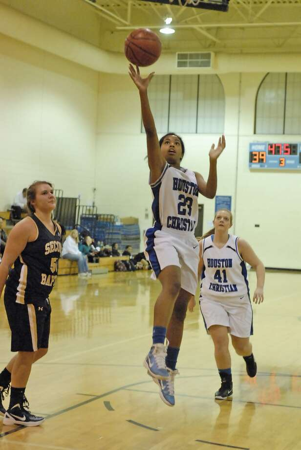 Houston Christian sophomore guard Jaela DeJean (#23) shoots from under the basket just before she went down with a knee injury as junior post Jessie Skinn (#41) backs her up with Second Baptist senior post Megan Milam (#50) at left during the 8th Annual UST Charlie Thomas Classic Thursday 11/03/11. Photo by Tony Bullard. Photo: Tony Bullard / Credit: for the Chronicle