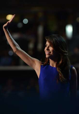 Obama Campaign Co-Chair Eva Longoria waves to the audience at the Time Warner Cable Arena in Charlotte, North Carolina, on September 6, 2012 on the final day of the Democratic National Convention (DNC). US President Barack Obama is expected to accept the nomination from the DNC to run for a second term as president. Photo: ROBYN BECK, AFP/Getty Images / AFP