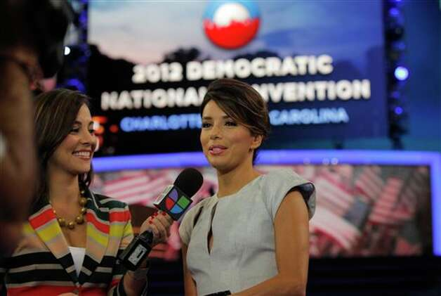 Actress Eva Longoria, right, is interviewed by Mariana Atencio of Univision on the floor of the Democratic National Convention in Charlotte, N.C., Thursday, Sept. 6, 2012. Photo: Charles Dharapak, AP / AP