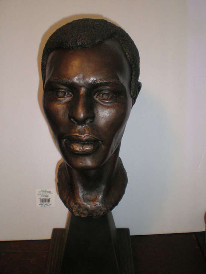 This cast  at the Buffalo Soldier National Museum is a reproduction of the face of Army Pvt. Thomas Smith, who died in 1866. Photo: Kenan Taylor And Amanda Danning