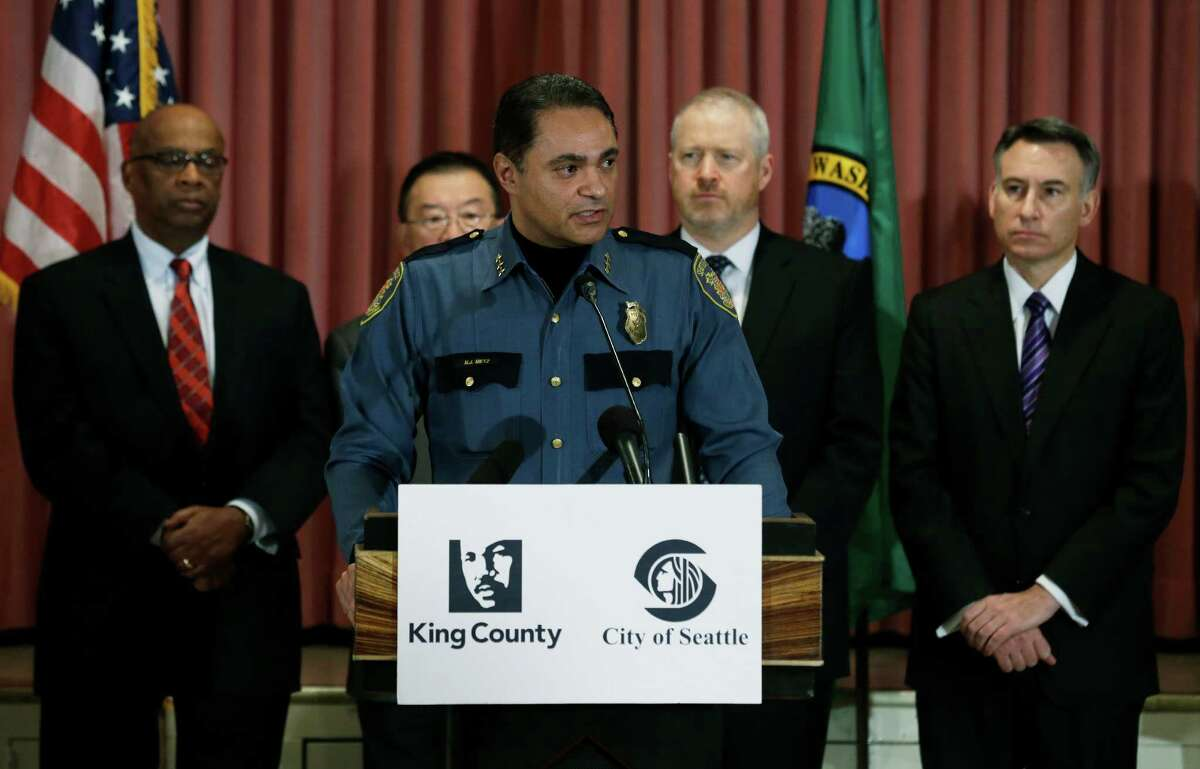 Seattle Deputy Police Chief Nick Metz speaks at a Jan. 8 news conference to announce a new gun buyback program that will begin later in January. Behind him, from left, is former Seattle mayor Norm Rice, Bellevue Mayor Conrad Lee, Seattle Mayor Mike McGinn, and King Co. Executive Dow Constantine. (AP Photo/Ted S. Warren)