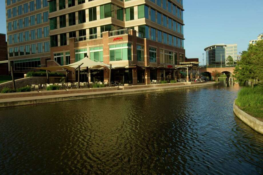 Sidewalk along the Woodlands Waterway Photo: Brett Coomer, Staff / Houston Chronicle