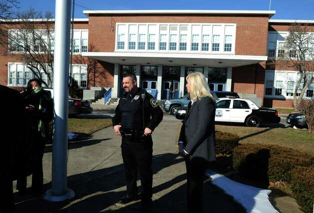 Officer Alec Voccola, the School Resource Officer, and Margaret Lasek, Interim Superintendent of Schools, stand outside Wooster Middle School in Stratford, Conn. Tuesday, Jan. 8, 2013.  The school was in lockdown briefly while authorities apprehended four men, two carrying what are believed to be hi-powered pellet rifles in the woods behind the school Tuesday around noon. Photo: Autumn Driscoll / Connecticut Post