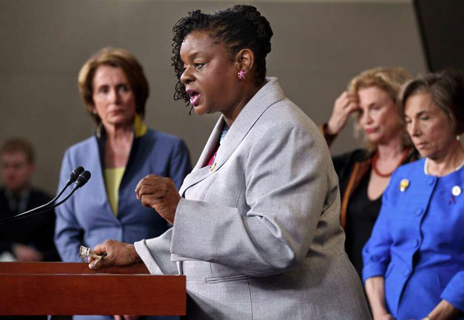 Rep. Gwen Moore, D-Wis. speaks in Washington about the reauthorization of the Violence Against Women Act.  One reader is unhappy because the Republican House allowed the act to expire. Photo: J. Scott Applewhite, Associated Press / AP