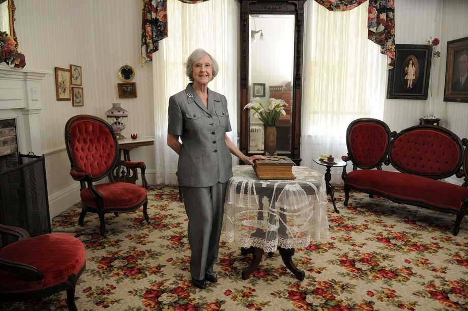 Jean Alexander, the director of the Spring Creek County Historical Association, stands in the formal parlor of the Griffin Memorial House. Eugene Pillot, who came to be a successful builder in Houston, constructed the house in 1860 near the Atascocita Trail.   Photo: Jerry Baker, Freelance