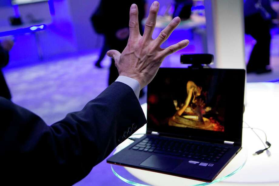 Jason Chow demonstrates perceptual technology with a Creative Technology Ltd. Interactive Gesture Camera at the Intel Corp. booth during the 2013 Consumer Electronics Show in Las Vegas, Nevada, U.S., on Tuesday, Jan. 8, 2013. The 2013 CES trade show, which runs until Jan. 11, is the world's largest annual innovation event that offers an array of entrepreneur focused exhibits, events and conference sessions for technology entrepreneurs. Photographer: Andrew Harrer/Bloomberg *** Local Caption *** Jason Chow Photo: Andrew Harrer, Bloomberg / © 2013 Bloomberg Finance LP