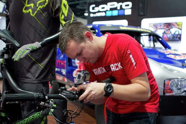 Hunter Clark sets up a GoPro Hero 3 camera on a bicycle during the 2013 Consumer Electronics Show in Las Vegas, Nevada, U.S., on Tuesday, Jan. 8, 2013. The 2013 CES trade show, which runs until Jan. 11, is the world's largest annual innovation event that offers an array of entrepreneur focused exhibits, events and conference sessions for technology entrepreneurs. Photographer: Andrew Harrer/Bloomberg *** Local Caption *** Hunter Clark Photo: Andrew Harrer, Bloomberg / © 2013 Bloomberg Finance LP