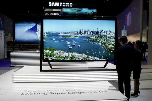 "Samsung Electronics Co. ultra HDTV ""Timeless Gallery"" televisions sit on display during the 2013 Consumer Electronics Show in Las Vegas, Nevada, U.S., on Tuesday, Jan. 8, 2013. The 2013 CES trade show, which runs until Jan. 11, is the world's largest annual innovation event that offers an array of entrepreneur focused exhibits, events and conference sessions for technology entrepreneurs. Photographer: Andrew Harrer/Bloomberg Photo: Andrew Harrer, Bloomberg / © 2013 Bloomberg Finance LP"