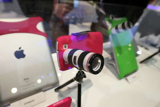 LAS VEGAS, NV - JANUARY 08:  A Polaroid lens adapter for an iPhone is displayed during the 2013 International CES at the Las Vegas Convention Center on January 8, 2013 in Las Vegas, Nevada. CES, the world's largest annual consumer technology trade show, runs from January 8-11 and is expected to feature 3,100 exhibitors showing off their latest products and services to about 150,000 attendees. Photo: Justin Sullivan, Getty Images / 2013 Getty Images