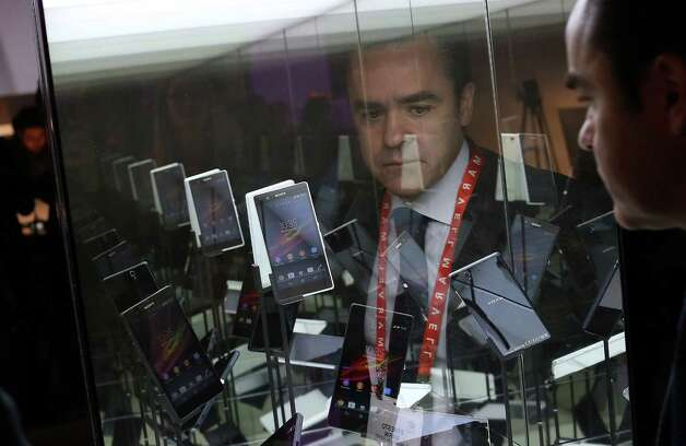 LAS VEGAS, NV - JANUARY 08:  An attendee views a display of Sony Xperia Z smart phones during the 2013 International CES at the Las Vegas Convention Center on January 8, 2013 in Las Vegas, Nevada. CES, the world's largest annual consumer technology trade show, runs from January 8-11 and is expected to feature 3,100 exhibitors showing off their latest products and services to about 150,000 attendees. Photo: Justin Sullivan, Getty Images / 2013 Getty Images