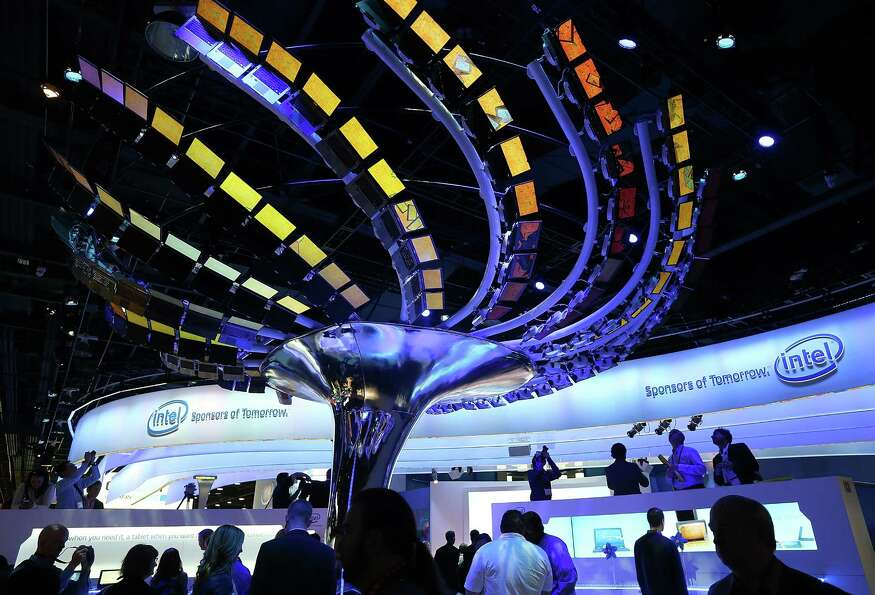 LAS VEGAS, NV - JANUARY 08:  Attendees visit the Intel booth during the 2013 International CES at th