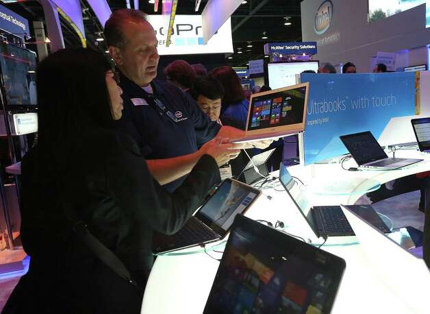 LAS VEGAS, NV - JANUARY 08:  Attendees inspect Intel UltraBooks during the 2013 International CES at the Las Vegas Convention Center on January 8, 2013 in Las Vegas, Nevada. CES, the world's largest annual consumer technology trade show, runs from January 8-11 and is expected to feature 3,100 exhibitors showing off their latest products and services to about 150,000 attendees. Photo: Justin Sullivan, Getty Images / 2013 Getty Images