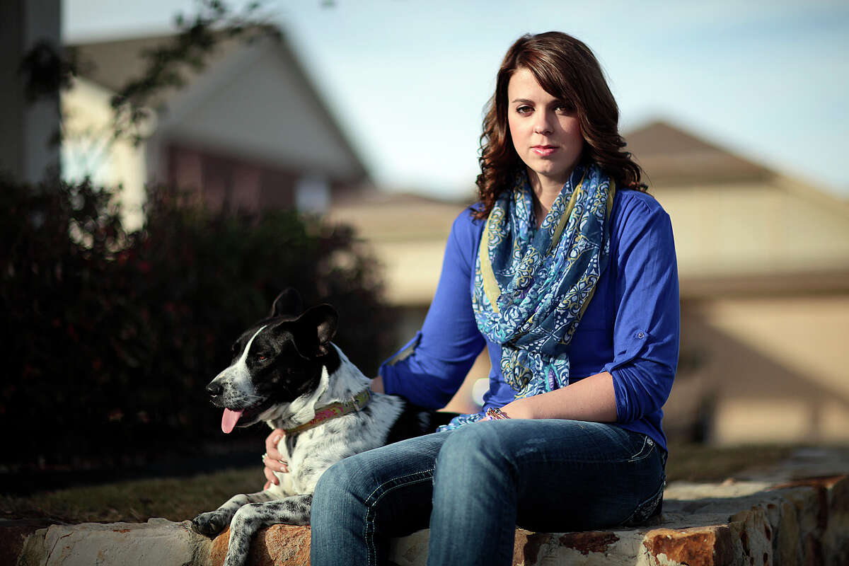Rebecca Morrison sits with dog Daisy at home in Grand Prairie. Morrison's husband, Capt. Ian Morrison, a helicopter pilot who was an Iraq war veteran, committed suicide last March while posted to Fort Hood.
