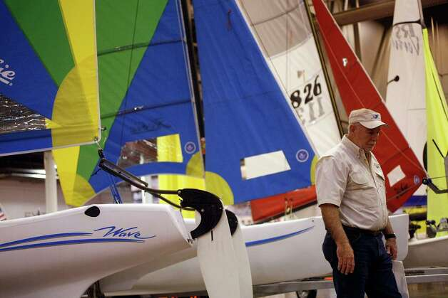 Jack Warren of Kingwood looks at kayaks and sailboats at the KO Sailing exhibit at the 56th Annual Houston International Boat, Sport & Travel Show at Reliant Center Monday, Jan. 7, 2013, in Houston. Photo: Johnny Hanson, Houston Chronicle / © 2012  Houston Chronicle
