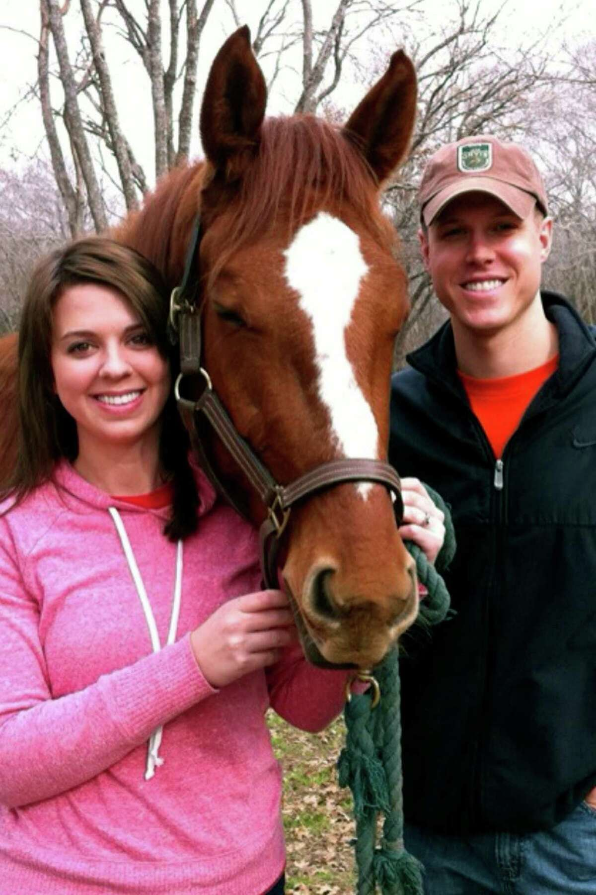 """Rebecca and Ian Morrison with the horse he bought after thinking of his wife's love of the animals. """"He was really quiet except when he was around me,"""" Rebecca said of her husband."""