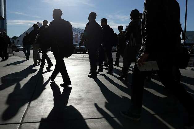 LAS VEGAS, NV - JANUARY 08:  Attendees arrive at the 2013 International CES at the Las Vegas Convention Center on January 8, 2013 in Las Vegas, Nevada. CES, the world's largest annual consumer technology trade show, runs from January 8-11 and is expected to feature 3,100 exhibitors showing off their latest products and services to about 150,000 attendees. Photo: Justin Sullivan, Getty Images / 2013 Getty Images