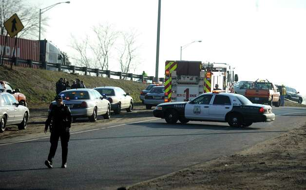 Police and emergency vehicles are parked on the entrance ramp for Interstate 95 southbound off of West Broad Street in Stratford Tuesday, Jan. 8, 2013 following a northbound chase that ended without any injuries.  Cops are still piecing together details of the incident, which began in Bridgeport and ended in Stratford at about 2:30 p.m. State police, as well as police from Bridgeport and Stratford, assisted in the chase. Photo: Autumn Driscoll / Connecticut Post