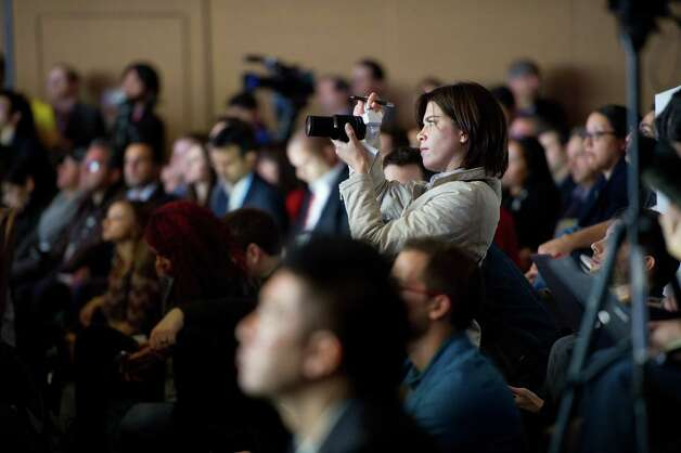 Members of the media listen as Tim Baxter, president of Samsung Electronics America Inc., not pictured, speaks during a news conference at the 2013 Consumer Electronic Show in Las Vegas, Nevada, U.S., on Monday, Jan. 7, 2013. The 2013 CES trade show, which runs until Jan. 11, is the world's largest annual innovation event that offers an array of entrepreneur focused exhibits, events and conference sessions for technology entrepreneurs. Photographer: David Paul Morris/Bloomberg Photo: David Paul Morris, Bloomberg / © 2013 Bloomberg Finance LP
